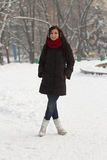 Cute brunette girl on snow Stock Photo