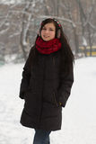 Cute brunette girl on snow Stock Images