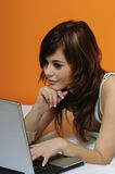 Cute brunette girl using laptop in bed Stock Photos