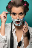 Cute brunette in hair curlers and foam posing with Royalty Free Stock Photos