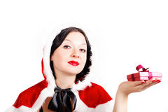 Cute brunette has prepared a Christmas gift Stock Image