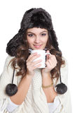 Cute brunette with hat and a cup Royalty Free Stock Image