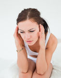 Cute brunette having a headache Royalty Free Stock Images