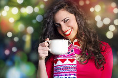 Cute brunette holding cup and smiling bokeh colorful background Stock Photography