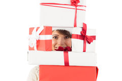 Cute brunette holding pile of gifts Royalty Free Stock Photos