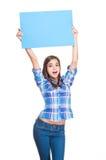 Cute brunette holding sign. Stock Image