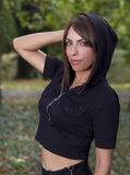 Cute brunette with hood on Stock Images