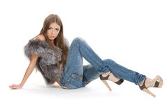 Cute brunette in jeans posing. On white Royalty Free Stock Image