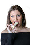 Cute brunette lady, eating a peeled banana Royalty Free Stock Photos