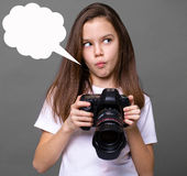 Cute brunette little girl holding an photo camera Stock Photo