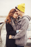 Cute brunette loving couple on a date. cold autumn, winter or sp Stock Image