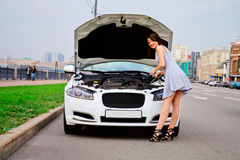 Cute brunette and luxury car Stock Photography