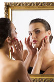 Cute brunette at mirror Stock Image