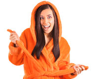 Cute brunette in an orange bathrobe Royalty Free Stock Photo