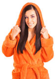 Cute brunette in an orange bathrobe Stock Photography