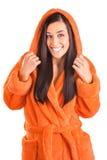 Cute brunette in an orange bathrobe Stock Images