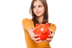 Cute brunette with piggy bank. Stock Image