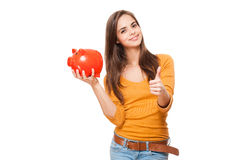 Cute brunette with piggy bank. Royalty Free Stock Image