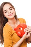 Cute brunette with piggy bank. Royalty Free Stock Photos