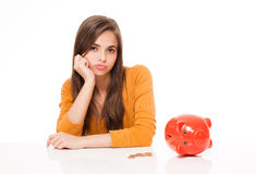 Cute brunette with piggy bank. Stock Photos