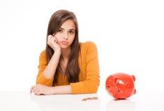 Cute brunette with piggy bank. Portrait of a cute brunette woman with piggy bank Stock Photos