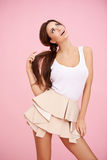 Cute brunette on pink Royalty Free Stock Image