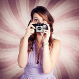 Pin-up Photographer Girl Taking Surprise Photo Royalty Free Stock Photography