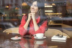 Cute brunette plus size woman working on a distance freelance, stock photo