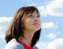 Cute brunette portrait. Cute young brunette looking to the sky Royalty Free Stock Photo