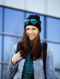 Cute brunette real teenage girl in hat, student Stock Images
