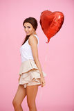 Cute brunette with red heart Royalty Free Stock Images