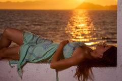 Cute brunette relaxing at the beach Stock Images