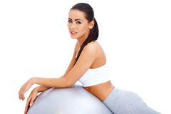 Cute brunette relaxing after exercises. On firness ball Royalty Free Stock Image