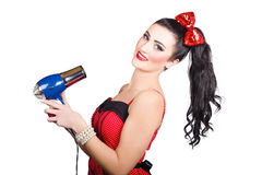 Cute brunette retro woman with hair dryer Royalty Free Stock Photography