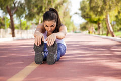 Cute brunette stretching Stock Images