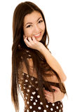 Cute brunette teen wearing a brown polka dot dress Stock Photo