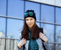 Cute brunette teenage girl in hat, student outside Royalty Free Stock Images
