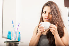 Cute brunette waking up with some coffee Stock Photos