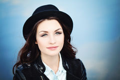 Cute Brunette Woman in Black Hat Stock Photography