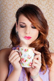 Cute Brunette Woman Drinking Hot Coffee Indoors Stock Photo