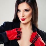 Cute Brunette Woman Fashion Model wearing Black Suit Stock Photography