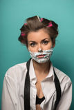 Cute brunette woman in hair curlers posing with. Cute funny  brunette woman in hair curlers wearing man shirt and tie undone posing with foam on face, isolated Stock Images