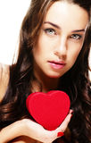Cute brunette woman holding red heart Stock Images