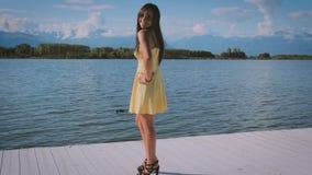 Cute brunette woman posing outdoors stock video footage