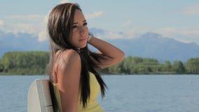 Cute brunette woman posing outdoors stock footage
