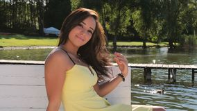Cute brunette woman posing outdoors stock video footage