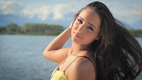 Cute brunette woman posing outdoors stock footage
