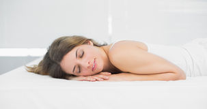 Cute brunette woman sleeping lying on her bed Royalty Free Stock Photos