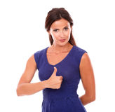 Cute brunette woman standing with thumbs up Stock Image