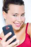 Cute brunette woman taking photo of herself Royalty Free Stock Photo